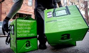 An Amazon worker delivering groceries from the online retailer's Fresh service in New York.