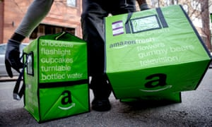 An Amazon Fresh worker delivers groceries in Brooklyn, New York.