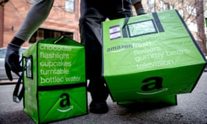An Amazon Fresh worker delivers groceries in Brooklyn, New York. The online retailer has presented its UK grocery plans to major food manufacturers in Britain.