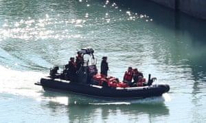A group of suspected migrants are brought to shore by Border Force officers at the Port of Dover in Kent after a number of small boat incidents in the Channel in September.