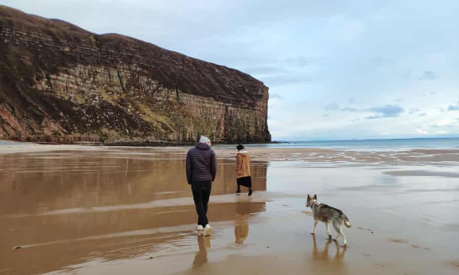 The writer with her partner and their dog at Rackwick.