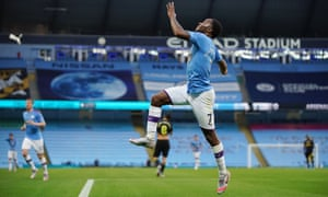 Raheem Sterling celebrates scoring the first goal actually given on the Premier League's return