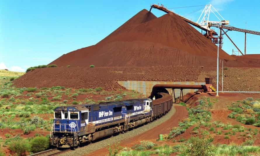 A train loaded with iron ore departs a BHP mine in the Pilbara, Western Australia.