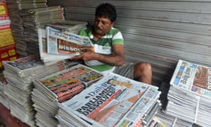 A Sri Lankan vendor displays newspapers for sale at a stall in Colombo