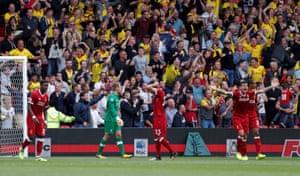 Simon Mignolet, Emre Can and Dejan Lovren looks dejected as Watford fans celebrate.