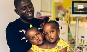 Ibrahima Ndiaye with his conjoined three-year-old daughters Marieme and Ndeye.