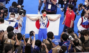 Daiki Hashimoto celebrates his men's all-around gymnastics gold. Japan ended day five still on top of the medals table with 13 golds.