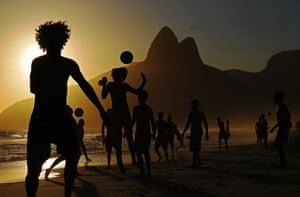 Boys play football on Ipanema beach in Rio de Janeiro, Brazil