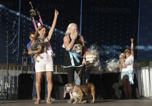 Megan Brainard (centre) reacts after her dog Zsa Zsa is announced the winner . Yvonne Morones (left) holds her dog Scamp, who placed second, and Linda Elmquist, with her dog Josie, who finished third