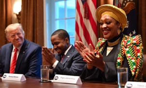 Donald Trump sits near Angela Stanton King during a meeting with African American leaders at the White House in February.
