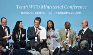 The director-general of the World Trade Organisation, Roberto Azevêdo together with Kenyan foreign minister Amina Mohamed hold the approved Nairobi ministerial declaration during the WTO conference in Nairobi, Kenya, 19 December 2015