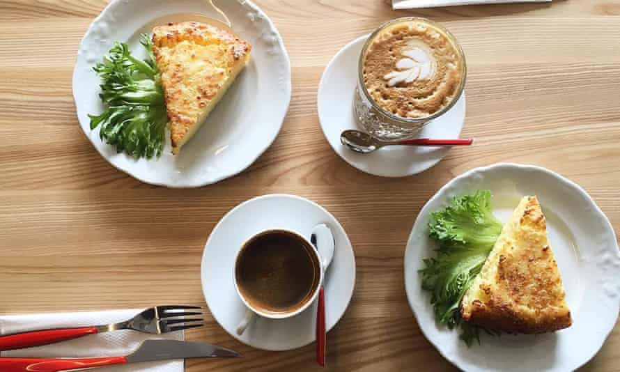 Omelettes and coffee on a wooden table at T35 Bakery, Kalamaja, Tallinn, Estonia.