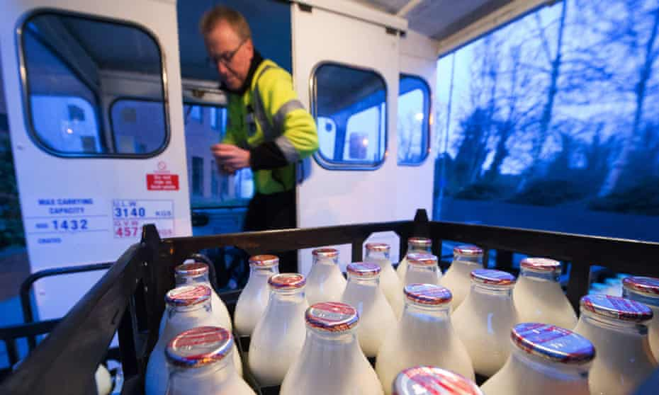 A milkman with his bottles on the milkfloat
