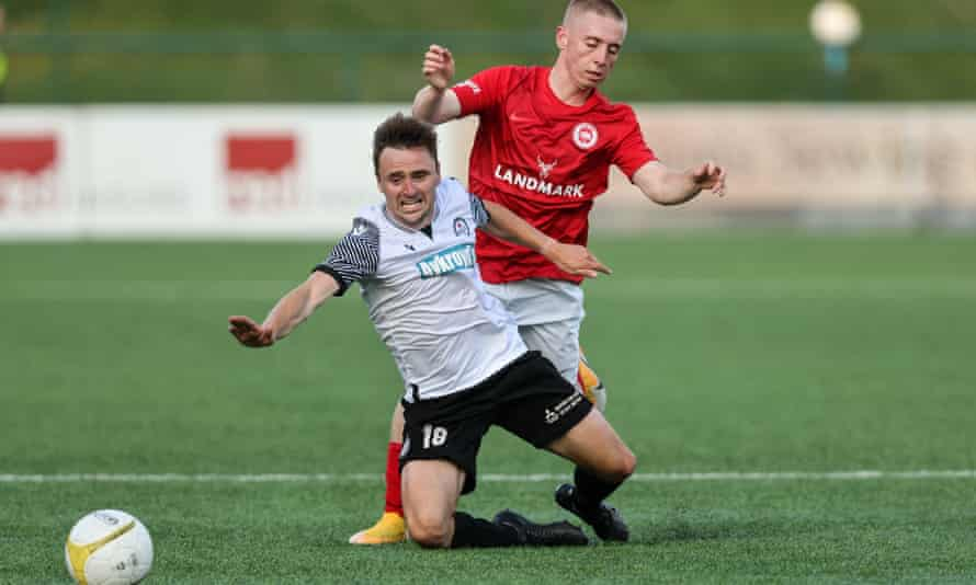 Paul Rutherford of Bala Town and Conor McKendry of Larne FC (right) tussle, with Larne winning 2-0 over two legs.