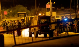 Israeli forces gather at the scene of a shooting at a checkpoint near the West Bank city of Ramallah.