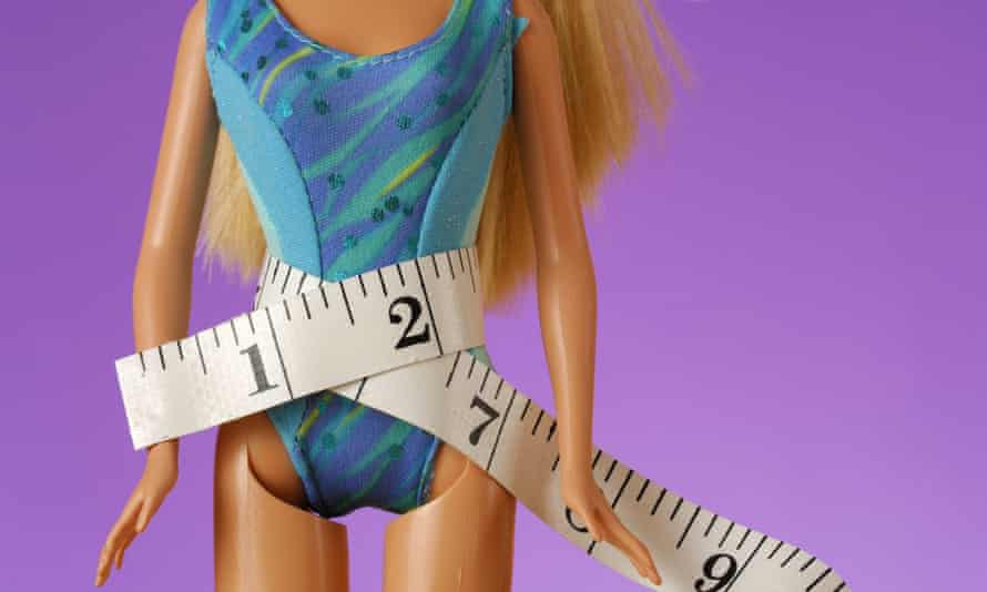 Barbie doll with a tape measure around her waist