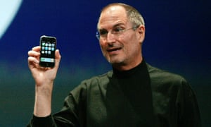 Apple Chief Executive Officer Steve Jobs holds the new iPhone in San Francisco.