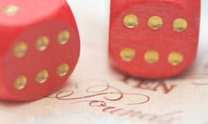 Two dice with a £10 note