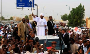 Omar al-Bashir greets cheering supporters at Khartoum airport
