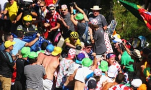 Chris Froome signals to fans to move out of the way as he climbs the Col de Soudet during stage 10 of the 2015 Tour de France.