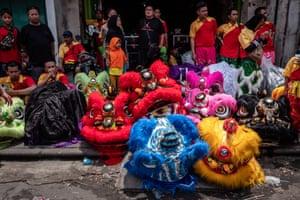 Barongsai dancers prepare before a performance during Grebeg Sudiro festival in Solo City, Central Java, Indonesia