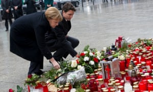 The German chancellor Angela Merkel and Canadian PM Justin Trudeau lay flowers in memory of victims of the Berlin truck attack.
