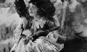Lassie Lou Ahern playing the role of Little Harry, right, with Margarita Fischer as Eliza in a scene from the film of Harriet Beecher Stowe's novel Uncle Tom's Cabin, 1927.