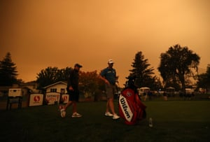 A pair of golfers practice under hazy conditions during the preview day of the Safeway Open at Silverado Country Club in Napa, California.Wednesday, 9 September 2020, in Napa, California.