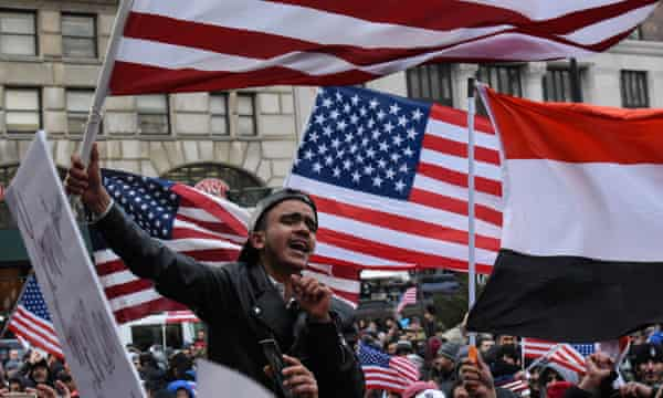 People participate in a Yemeni protest against President Donald Trump's travel ban at Borough Hall in Brooklyn on Thursday.