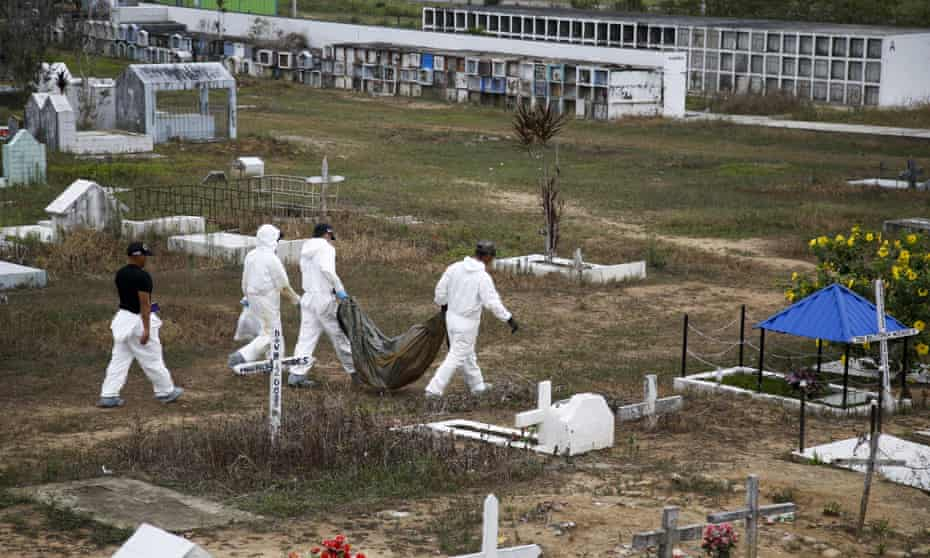 Forensic science workers carry an unidentified body at the cemetery in La Macarena, Colombia. Criminal investigators are digging up bodies in the cemetery in hopes of identifying 464 that were buried in unmarked graves after 2002.