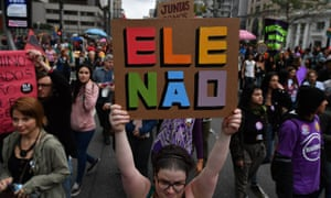 Anti-Bolsonaro protesters display placards with the hashtag #EleNao (not him) in Sao Paulo on Saturday.
