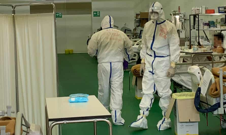 The Russians are instantly recognisable because they have their own distinctive PPE: white hazmat suits with blue stripes.