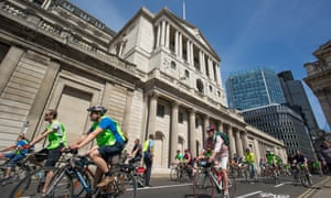 A group of cyclists pass the Bank of England during the Prudential RideLondon FreeCycle.