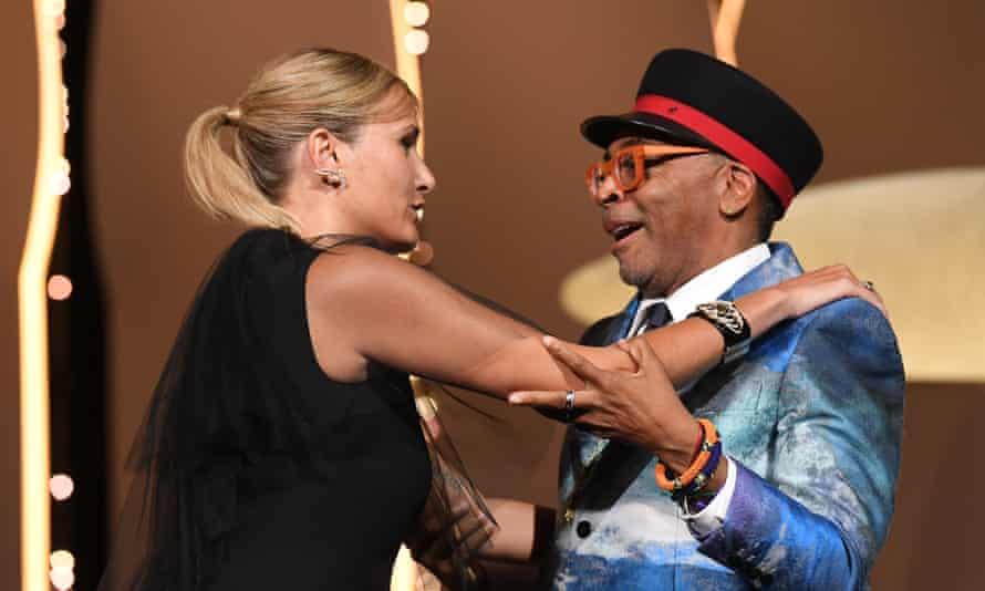 Jury president Spike Lee greets Julia Ducournau as she wins the Palme d'Or.