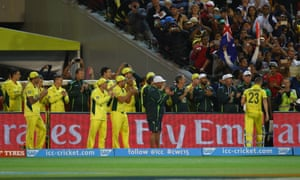 The Australian team and management applaud Michael Clarke as he leaves the field.