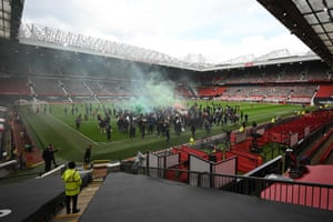 Manchester United fans somehow get access to the Old Trafford pitch before the match with Liverpool