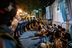 Protesters are detained at the Central Government Complex on 10 June in Hong Kong.