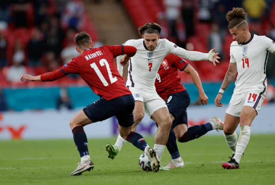 Czech players try to tackle Jack Grealish, who set up Raheem Sterling's winner, as Kalvin Phillips looks to get involved.