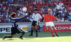 Dennis Bergkamp fire the ball past Argentina goalkeeper Carlos Roa for the Netherland's last minute winner.