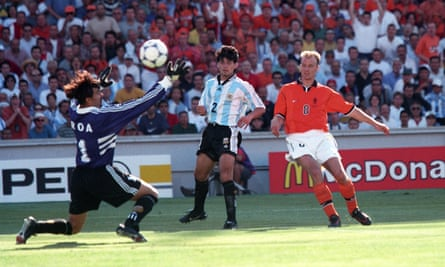 Dennis Bergkamp scores past Carlos Roa as Roberto Ayala looks on during the 1998 World Cup match between Holland and Argentina in Marseille.
