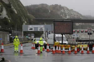 Security guards patrol the entrance to the ferry terminal at the port of Dover in England