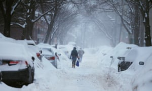 Pedestrians make their way along a snowy street in Cambridge, Massachusetts. The Weather Channel app is marketed as 'the world's most downloaded weather app'.