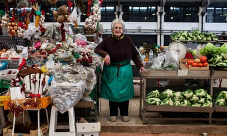 Stallholder at Mercado da Ribeira, Lisbon, Portugal.