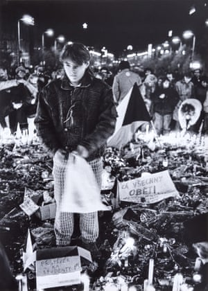 25 November 1989, 21:30: A young man reflects at the spot where Czech student Jan Palach set fire to himself in Wenceslas Square in January 1969, in protest at the crushing of the Prague Spring