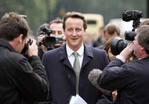 David Cameron surrounded by press photographers in 2005