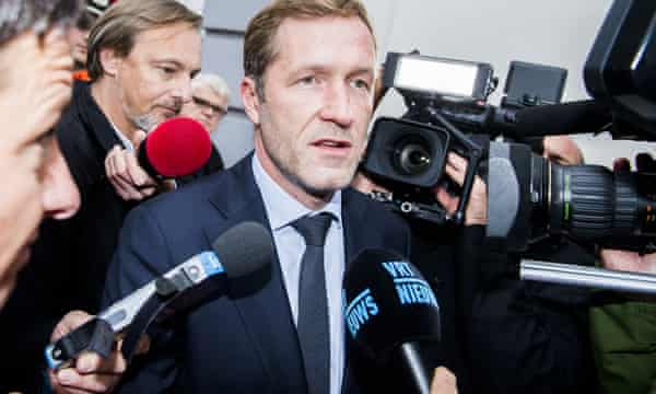 Walloon minister-president Paul Magnette talks to the press