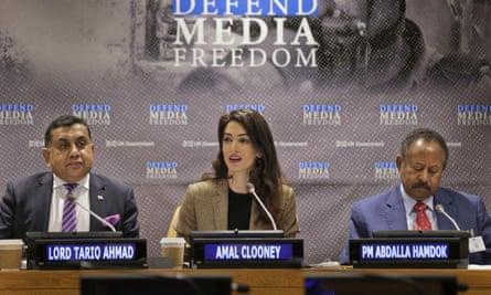 Amal Clooney, Tariq Ahmad and Abdalla Hamdok at a conference