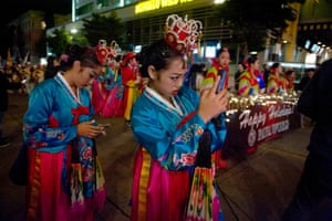 Participants in traditional costume take photos