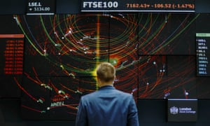 The FTSE 100 share index board in the atrium of the London Stock Exchange Group's offices.