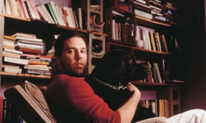 An awful lot to read ... David Foster Wallace in 1996, with his books and his dog.